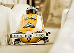 8 January 2016: Nico Walther, piloting his 2-man bobsled for Germany, enters the Chicane straightaway on his first run, ending the day with a combined 2-run time of 1:51.11 and earning a silver medal at the BMW IBSF World Cup Championships at the Olympic Sports Track in Lake Placid, New York, USA. Mandatory Credit: Ed Wolfstein Photo *** RAW (NEF) Image File Available ***
