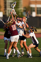 Julie Gardner (24) of Virginia and teammate (4) Claire Banta fights for the ball with Jessica Nonn (12) and Julie Wolfinger (14) and Allie Emala (22) of Virginia Tech during the first round of the ACC Women's Lacrosse Championship in College Park, MD.  Virginia defeated Virginia Tech, 18-6.