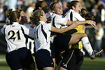 05 December 2004: Notre Dame goalkeeper Erika Bohn (right) is tackled by her teammates after her penalty kick save won the championship. Notre Dame defeated UCLA 4-3 on penalty kicks after the game ended in a 1-1 overtime tie at SAS Stadium in Cary, NC in the championship match in the 2004 NCAA Division I Women's College Cup..