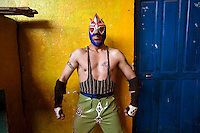 Wrestler Picudo (fighting name), Ruben Averanga (real name) poses in his costume outside the changing room at the Multifuncional building where every Sunday wrestling takes place.