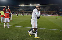 The USA's  (left to right) Stuart Holden, Jozy Altidore, and Herculez Gomez (behind Altidore) celebrate defeating Algeria 1-0 to win Group C and advancing to the second round of the 2010 FIFA World Cup.  USA played Algeria in a 2010 FIFA World Cup first round match at Loftus Versfeld Stadium in Tshwane/Pretoria, South Africa on Wednesday, June 23, 2010.