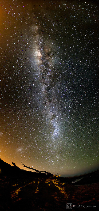 The Milky Way in all it's glory. Captured above a remote beach early one morning near Palmerston North in New Zealand. Shot with a fisheye lens, this photo is actually a stitch of two photos & almost covers 180 degrees of the sky from horizon to horizon.