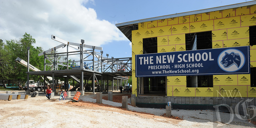 NWA Democrat-Gazette/ANDY SHUPE<br /> Visitors walk Wednesday, April 19, 2017, into The New School's Innovation Center during a beam raising and tour of the school's expansion project in Fayetteville. The New School hopes to open the facility in the fall for the 2017-18 school year.