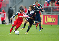 22 October 2011: New England Revolution defender Kevin Alston #30 and Toronto FC forward Joao Plata #7 in action during a game between the New England Revolution and Toronto FC at BMO Field in Toronto..The game ended in a 2-2 draw.