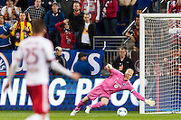 Sporting Kansas City goalkeeper Jimmy Nielsen (1) dives for a shot. Sporting Kansas City defeated the New York Red Bulls 1-0 during a Major League Soccer (MLS) match at Red Bull Arena in Harrison, NJ, on April 17, 2013.