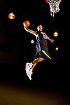 Derrick Rose dunks a basketball during a portrait session while he was a senior at Simeon High School.