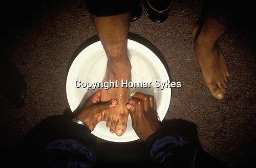 Church of God of Prophecy London. Sunday Morning Church Service Feet washing ritual. The Pastor washes the feet of his congregation. After the Lords Supper in the Church of God of Prophecy, a feet washing ceremony takes place a practice sanctioned by the Gospels and also practised in some Roman Catholic churches.