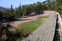 DELPHI, GREECE - APRIL 11 : A general view of the western and best preserved track of the Stadium on April 11th, 2007, in the Sanctuary of Apollo, Delphi, Greece. The Stadium was built in the 5th century BC and remodeled in the 2nd century AD when Herodus Atticus ordered the stone seating and the arched entrance. (Photo by Manuel Cohen)