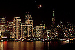 The crescent moon settles in to the evening  San Francisco skyline.