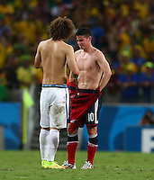 David Luiz of Brazil swaps shirts with an emotional James Rodriguez of Colombia at full time