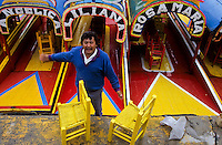 Mexican man trying to get a customer for touring on his colorfull boat in Xochimilco floating garden, Mexico city