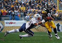 PITTSBURGH, PA - OCTOBER 30:  Rashard Mendenhall #34 of the Pittsburgh Steelers evades a tackle from Rob Ninkovich #50 of the New England Patriots during the game on October 30, 2011 at Heinz Field in Pittsburgh, Pennsylvania.  (Photo by Jared Wickerham/Getty Images)