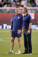 United States head coach Jurgen Klinsmann (R) talks with assistant coach Thomas Dooley (L) before the match. The men's national teams of the United States (USA) and Mexico (MEX) played to a 1-1 tie during an international friendly at Lincoln Financial Field in Philadelphia, PA, on August 10, 2011.