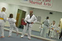 Young boy and girls train in martial arts school, Richmond, VA