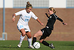 27 November 2009: North Carolina's Amber Brooks (22) and Wake Forest's Casey Luckhurst (2). The University of North Carolina Tar Heels defeated the Wake Forest University Demon Deacons 5-2 at Fetzer Field in Chapel Hill, North Carolina in an NCAA Division I Women's Soccer Tournament Quarterfinal game.