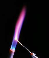 LITHIUM FLAME TEST<br /> (Variations Available)<br /> Magenta Flame Shows Presence Of Lithium<br /> (Alkali metal)<br /> Lithium compound is dissociated by flame into gaseous atoms, not ions. The atoms of the element are raised to excited state by high temperature of flame. Excess energy from the atom is emitted as light of a characteristic wavelength.
