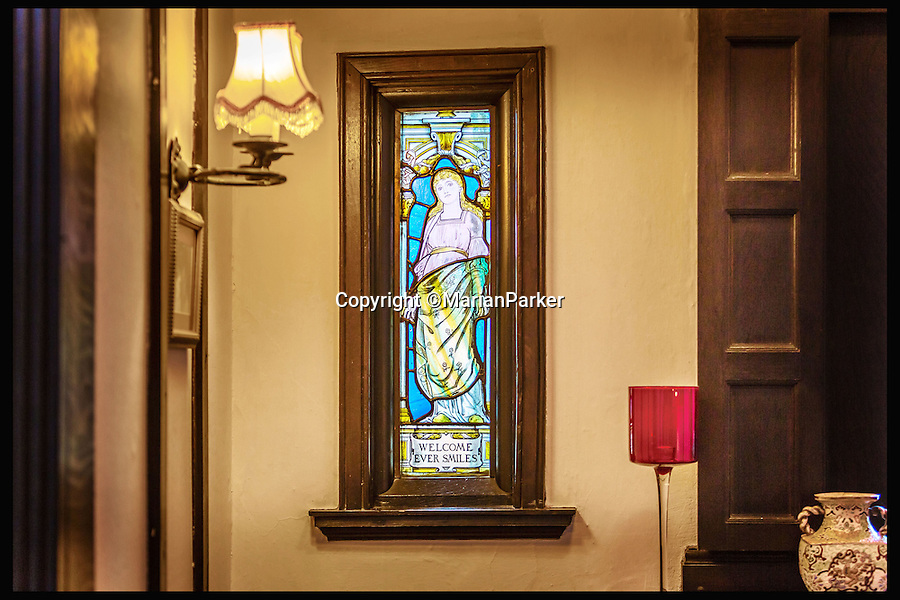 BNPS.co.uk (01202 558833)<br /> Pic: MarianParker/BNPS<br /> <br /> Art's and crafts window.<br /> <br /> Colonial time capsule - Yours for &pound;1 million.<br /> <br /> The finest original bungalow that remains from Victorian time's is for sale - with a lot more style &amp; grandeur than its hum-drum modern descendents.<br /> <br /> Pleasaunce Cottage in East Grinsted has been meticulously maintained over decades to keep much of its original charm with authentic wood panelling and stained glass windows.<br /> <br /> It is said to be the finest example of a colonial India-style bungalow that exists in this country today and features on the Society for the Protection of Ancient Buildings (SPAB) property list.