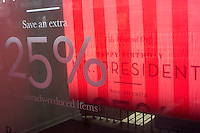 A Banana Republic store in midtown Manhattan in New York advertises its President's Day sales on President's Day, Monday, February 18, 2013.  (© Richard B. Levine)