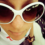 close-up of a girl with big white sunglasses