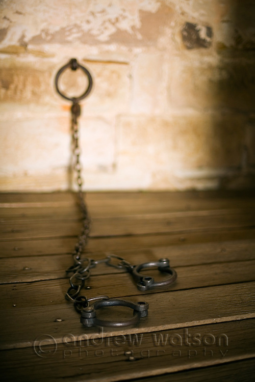 Leg irons at old Richmond Gaol.  Built in 1825 and used as a gaol until 1928, the building is a grim reminder of Tasmania's convict history.   Richmond, Tasmania, Australia