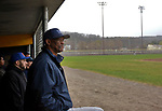 TORRINGTON, CT-042017JS13- Wolcott Tech head coach Rene Williams watches his team from the dugout during their game against Harding Wednesday at Fuessenich Park in Torrington. <br /> Jim Shannon Republican-American