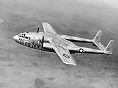 """The C-119, developed from the World War 2 Fairchild C-82, was designed to carry cargo, personnel, litter patients, and mechanized equipment, and to drop cargo and troops by parachute. The first C-119 made its initial flight in November, 1947 and by the time production ceased in 1955, more than 1,100 C-119s had been built. The United States Air Force (USAF) used the airplane extensively during the Korean War and many were supplied to the United States Navy and Marine Corps and to the Air Forces of Canada, Belgium, Italy, and India. In South Vietnam, the airplane once again entered combat, this time in a ground support role as AC-119 """"gunships"""" mounting side-firing weapons capable of firing up to 6,000 rounds per minute per gun. .Credit: U.S. Air Force via CNP"""