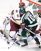 Tim Filangieri (Boston College - Islip Terrace, NY) deals with Tim Kennedy (Michigan State - Buffalo, NY) as Cory Schneider (Boston College - Marblehead, MA) gets his stick on the puck. The Michigan State Spartans defeated the Boston College Eagles 3-1 (EN) to win the national championship in the final game of the 2007 Frozen Four at the Scottrade Center in St. Louis, Missouri on Saturday, April 7, 2007.