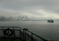 Ferry boats cut through the fog on their way into downtown Seattle.