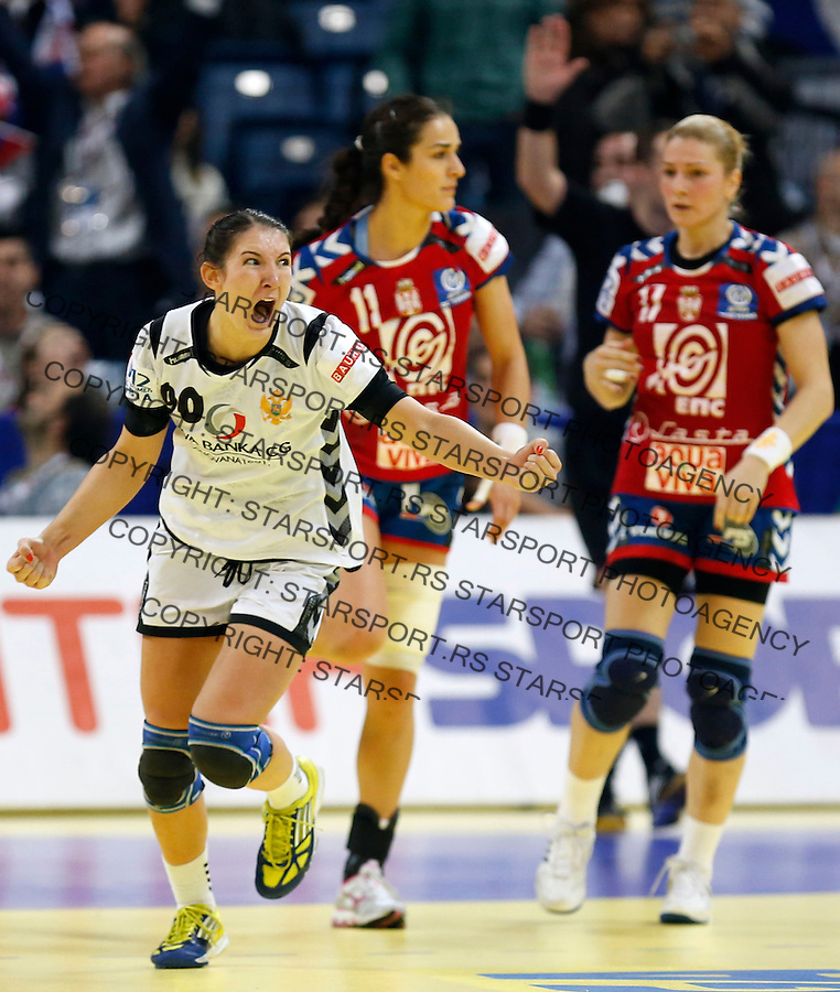 BELGRADE, SERBIA - DECEMBER 15:  Milena Knezevic of Montenegro (L) celebrates the score near Sanja Damjanovic (C) and Sanja Rajovic (R) of Serbia during the Women's European Handball Championship 2012 semifinal match between Serbia and Montenegro at Arena Hall on December 15, 2012 in Belgrade, Serbia. (Photo by Srdjan Stevanovic/Getty Images)
