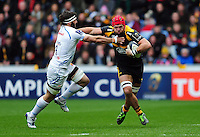 James Haskell of Wasps fends Don Armand of Exeter Chiefs. European Rugby Champions Cup quarter final, between Wasps and Exeter Chiefs on April 9, 2016 at the Ricoh Arena in Coventry, England. Photo by: Patrick Khachfe / JMP
