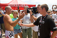 Eight times world champion KELLY SLATER(USA)talks to the press after he was defeated by wildcard entry JULIAN WILSON (AUSTRALIA)  in Round 1 action at the Quiksilver Pro Gold Coast. The day  was full of upsets after the ASP Foster's Top 45 did battle in the three to four foot (1 to 1.2 metre) surf at Snapper Rocks today, March. 1 2007. Photo: Joli