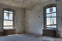 In 1990, the Ellis Island Immigration Museum opened on the island's north side.  However, some thirty buildings on the south side remain un-restored.  This room on the south side overlooks Lady Liberty. High Definition Range (HDR) image.