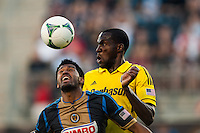 Tony Tchani (6) of the Columbus Crew watches as Sheanon Williams (25) of the Philadelphia Union plays the ball. The Philadelphia Union defeated the Columbus Crew 3-0 during a Major League Soccer (MLS) match at PPL Park in Chester, PA, on June 5, 2013.