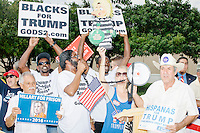 A small group of pro-Trump protesters gathered outside a campaign rally for Democratic presidential nominee Hillary Clinton in the Theodore R. Gibson Health Center at Miami Dade College-Kendall Campus in Miami, Florida, USA. The protesters shouted hateful language to people lined up to enter the rally.