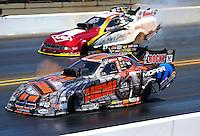 Jul. 27, 2014; Sonoma, CA, USA; NHRA funny car driver Matt Hagan (near lane) races alongside Tim Wilkerson during the Sonoma Nationals at Sonoma Raceway. Mandatory Credit: Mark J. Rebilas-