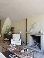 The original features of the house have been restored including the open fireplace in the living room
