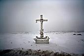 Niegowa 01.2010 Poland<br /> Frozen Cross on the Road.<br /> Three atmospheric forces: rain, snow and frost have changed into an ecological disaster the Myszkowski district in the Czestochowskie province, located 230 kilometers south of Warsaw. Almost 95% of all trees are down.Thousands of homes are left without electricity<br /> Photo: Adam Lach / Napo Images for Newsweek Polska<br /> <br /> Zamarzniety krzyz na drodze w pow.myszkowskim.<br /> Wstepnie &quot;tylko&quot; 95% scietych drzew w dwoch powiatach. 0.5 miliona metrow szesciennych zniszczonych lasow..Tysiace gospodarstw bez pradu. Wszyscy maja swiadomosc, ze na kumulacje trzech niekorzystnych .zjawisk atmosferycznych rady nie ma.Trzy zjawiska kt&oacute;re zamienily jeden z obszarow Polski w istna katastrofe ekologiczna: deszcz, snieg i szadz.<br /> Fot: Adam Lach / Napo Images dla Newsweek Polska