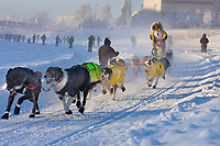 Musher Didier Moggia mushes down the Chena river at the start of the 2008 Yukon Quest in Fairbanks, Alaska.
