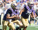Washington Huskies' quarterback Cyler Miles (10) scrambles against the Eastern Washington Eagles' at Husky Stadium September 6, 2014 in Seattle. Miles passed for 180 yards and one touchdown, rushed for 59 yards and three touchdowns as the Huskies out lasted the Eagles in a high powered shootout 59-52 in the third highest scoring game in Husky history. ©2014. Jim Bryant  Photo. All Rights Reserved.