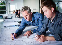 Jeff Berghoff left, works with his design director, Jeremy McVicars on a client's landscape design. Burghoff's company not only designs major residential landscape projects but provides a maintennance service for completed projects as well.