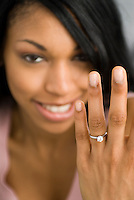 African American woman showing engagement ring
