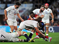 Fulgence Ouedraogo of France  is tackled by Tom Wood and Geoff Parling of England. QBE International match between England and France on August 15, 2015 at Twickenham Stadium in London, England. Photo by: Patrick Khachfe / Onside Images
