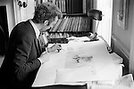 Patrick Procktor artist London 1969. Patrick signing an aquatint for the photographer given as a gift inexchange for some photographs I had taken of him. Manchester Street flat. <br /> My ref 19/11/1969.