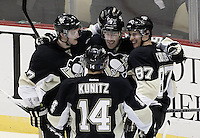 PITTSBURGH, PA - NOVEMBER 21:  Sidney Crosby #87 of the Pittsburgh Penguins celebrates with teammates after scoring his second goal of the season in the third period against the New York Islanders during the game on November 21, 2011 at CONSOL Energy Center in Pittsburgh, Pennsylvania. Crosby has not played a game since January 5th after sustaining a concussion.  (Photo by Jared Wickerham/Getty Images)