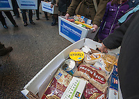 "Volunteers promote the 2nd annual ""Feeding our Neighbors: An Interfaith Response"" in front of St. Patrick'sCathedral in New York on Sunday, January 27, 2013. The campaign is an interfaith effort between Catholic Charities and the UJA-Federation social service organizations to collect food donations to re-fill the sorely depleted food pantries, meal programs  and soup kitchens that serve those in need.  (© Richard  B. Levine)"