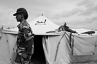 En Geneina, West Darfur, August 8, 2004.Janjaweed outpost near the city. Said Mohammed, behind him on the tent, his horse saddle....