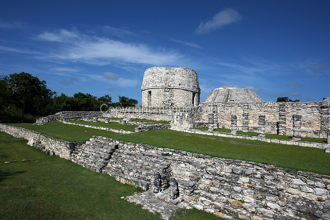 Round temple called the Observatory with the Pyramid of Kukulcan in the distance, Mayapan, old Maya capital, c. 1250, destroyed during civil war in 1441, Yucatan, Mexico Picture by Manuel Cohen