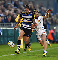 Matt Banahan of Bath Rugby puts in a grubber kick despite the challenge of James Short of Exeter Chiefs. West Country Challenge Cup match, between Bath Rugby and Exeter Chiefs on October 10, 2015 at the Recreation Ground in Bath, England. Photo by: Patrick Khachfe / Onside Images
