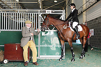 4/8/2010. Michael Dempsey is pictured speaking to Niamh Ennis from Howth and horse Porche Runkum in the stables of the Failte Ireland RDS Horse Show. Picture James Horan/Collins Photos