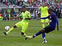 Seattle Sounders FC defender James Riley tries to block the shot of Manchester United forward Ashley Young during play at CenturyLink Field in Seattle Wednesday July 20, 2011. Manchester United won the match 7-0.
